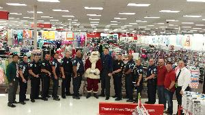 A group of police officers stand with Santa